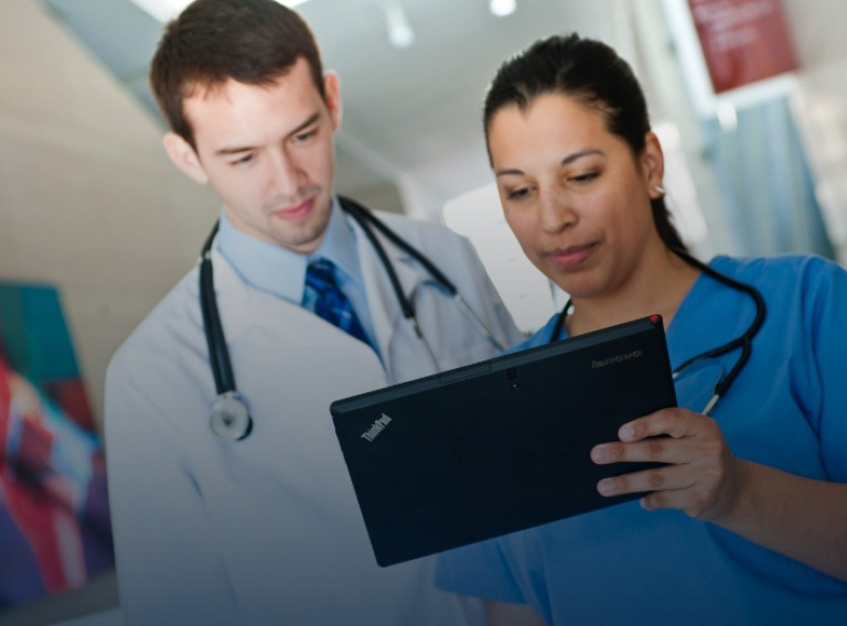 doctor and nurse using a lenovo tablet in a hospital