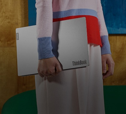 Woman holding a ThinkBook business laptop